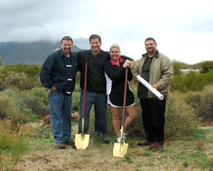 Paul and Teresa M breaking ground with Mike and Charlie Frat for their new custom home